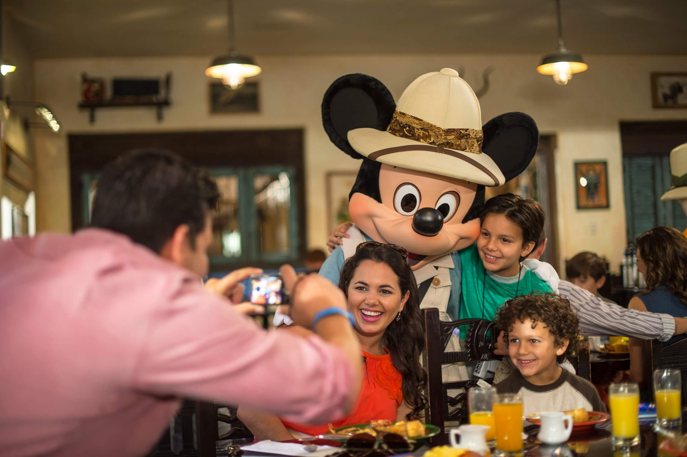 Family being photographed with Mickey at Tusker House