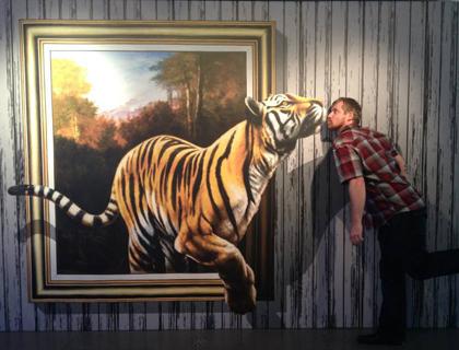 Man with tiger CSI experience Orlando 3D art exhibit