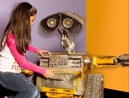 Little girl touching a life-sized figure of Wall-E at Ripley's Believe it or Not Orlando