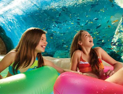 Two girls on the Loggerhead Lane ride at Aquatica