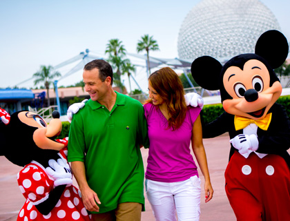 Couple with Minnie and Mickey Mouse at Epcot