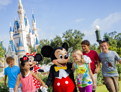 Minnie and Mickey Mouse with kids outside Sleeping Beauty's Castle