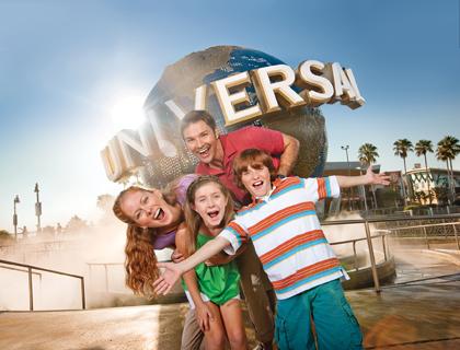 Family posing infront of Universal Studios sign at Universal Orlando Resort