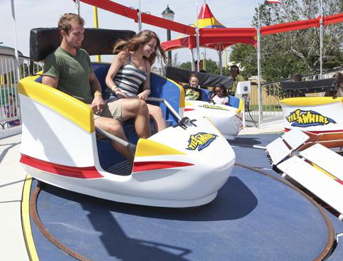 Couple enjoying the Tilt-a-Whirl ride at Fun Spot Orlando