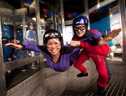 Couple enjoying the IFLY Skydiving experience
