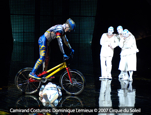 Cirque du Soleil performer doing a trick on a bicycle