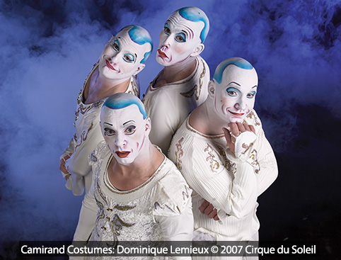 Four Cirque du Soleil performers posing with different faces to show different emotions