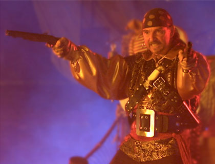 Pirate with gun at Pirates Adventure show