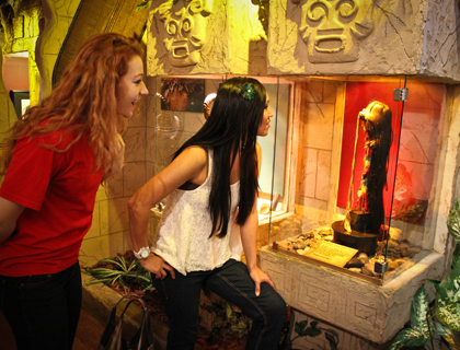Two young women staring at a real shrunken head exhibited in Ripley's Believe it or Not Orlando