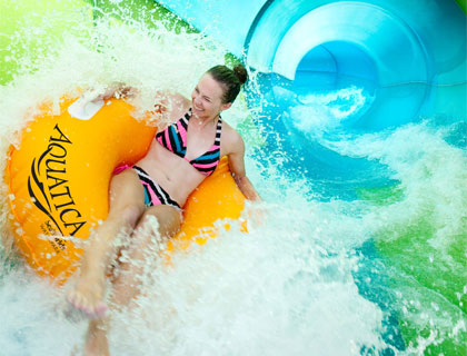 Girl getting splashed on the Whanau Way Ride at Aquatica