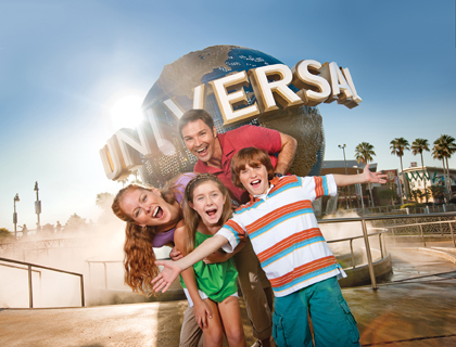 Family posing infront of Universal Studios sign at Universal Orlando Resort