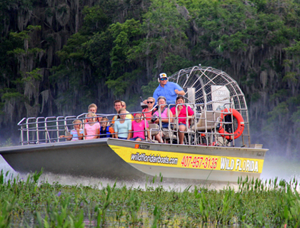Wild Florida tour boat with guests looking around